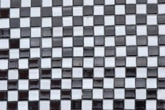 Black and White Checkerboard Abstract Texture. Black and white glass tile arranged in a checkerboard pattern for abstract texture background Royalty Free Stock Photo