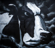 Black-white gloomy cow of graffiti drawing on street wall Royalty Free Stock Photo