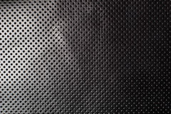 Black and white gradient perforated leather texture background Stock Photos
