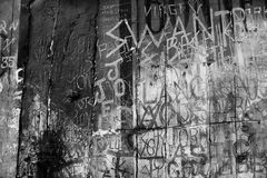 Black and white graffito. Ancient graffiti etched in to plaster wall. Monochrome. Gritty looking design background for that grunge look Stock Photo