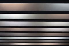 Black, white, gray stripes of different size, abstract backgroun Stock Photos