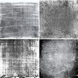 Black and white grunge textures. Collection of four black and white textures Stock Images