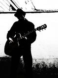 Play the song. Guitar player without face - black and white Royalty Free Stock Photo