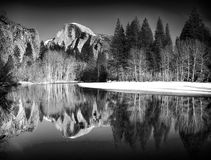 Black and White Half Dome Reflections. Black and white view of half dome reflected in the Merced river at Yosemite National Park Stock Image