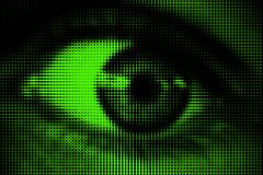Black and white halftone dotted eye on green background Stock Image