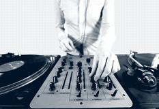 Black and white halftone image of a funky female dj Royalty Free Stock Photos