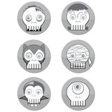 Black and white Halloween Monster  skulls such as  vampire, zombie, Woolf man, cyclops and mummy in button form with a shadow elem Stock Photos