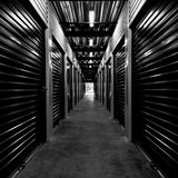 Black and white hallway. A Black and white hallway of a storage facility Stock Photos
