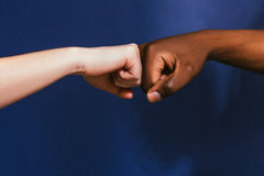 Black and white hand, fist bump gesture, contrast. Hand Black White Interracial Fist Bump Gesture Contrast Relationship Friendship International Unity Concept Royalty Free Stock Image