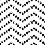 Black and white hand painted dot chevron ornament grunge seamless pattern, vector. Background Royalty Free Stock Images