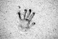 Black And White Hand Print in Pavement Royalty Free Stock Photos