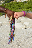 Black and white hands and African bracelets Stock Photography