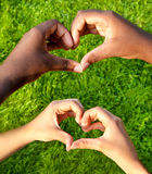 Black and white hands in heart shape, interracial friendship concept. Black and white hands in heart shape, interracial friendship Royalty Free Stock Images