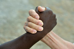 Black and white hands held together Royalty Free Stock Photography