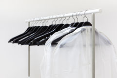 Black and white hangers with rack. Nobody Royalty Free Stock Photo
