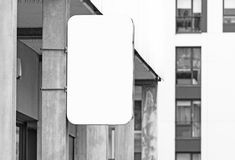 Black and white hanging wall signboard jpeg mockup. Hanging wall signboard jpeg mockup, modern style outdoor signage with copy space, company sign to add logo or royalty free stock images