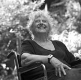 Black and white happy people. Happy old woman on a wheelchair Royalty Free Stock Photo