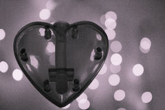 Black and white heart over blurred bokeh effect background Stock Image