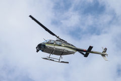 Black and White Helicopter flying over Istanbul City Royalty Free Stock Photos