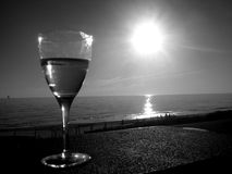 Black & White Henley Wine 1. Photo taken near sunset of a glass of wine at Henley Beach, Adelaide, South Australia royalty free stock photos