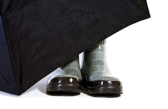 Black and White Herringbone Boots with Umbrella Stock Photo