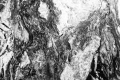 Black and white high contrast marble texture. Desaturated high contrast image royalty free stock photos