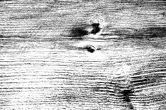 Black and white high contrast wooden texture. Lengthwise cut with knots and vertical scratches stock images