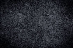 Black and white horizontal plaster concrete wall. Background. Dark edged Royalty Free Stock Image