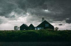 Black and White House Under Thick Clouds Royalty Free Stock Image