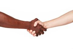 Black and white human hands in a modern handshake