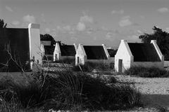 Black and White Huts. Slave huts of Bonaire, in black and white Royalty Free Stock Photography