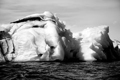Black and white icebergs in Arctic Ocean Royalty Free Stock Image