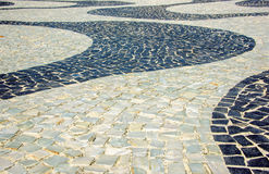 Black and white iconic mosaic by old design pattern at Copacabana Beach, Rio de Janeiro, Brazil Stock Photos