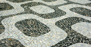 Black and white iconic mosaic, Portuguese pavement by old design pattern at Ipanema beach, Rio de Janeiro Royalty Free Stock Photo