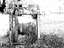 black and white illustration of an old winch with a rope stock illustration