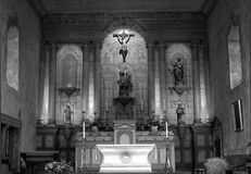 Black and white image of an 18th Century Mission Church. Awash with glowing light Stock Photo