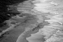 Black and white image 3. Another black and white images taken from a cliff looking down on the land, sand and ocean Stock Photos