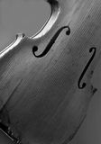 Black and white image of an antique violin on display. In the Santa Barbara Mission Stock Photo