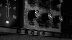 Black and white image of antique wall radio unit Stock Photography