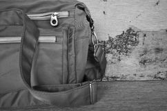 Black and white image of bag. On wood background Royalty Free Stock Image