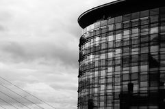BBC. Black and white image of BBC offices with bridge supports to the left of frame and a bird Stock Image
