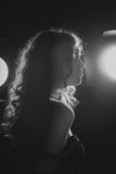A black and white image of a beautiful young woman. Film noir style. Filtered. A black and white image of a beautiful young woman with flowing hair. Film noir Stock Photos