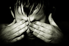 Black and white image of boy rubbing his eyes Royalty Free Stock Photos