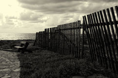 Black and white image of broken wooden fence Royalty Free Stock Photos