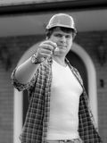 Black and white image of building site manager giving keys from Stock Photo