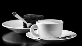 Black and white image of coffee and cake Royalty Free Stock Photo