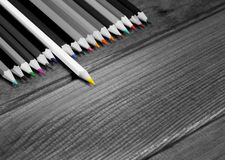 Black and white image of colored pencils with isolated pencil Royalty Free Stock Image