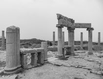 Black and white image of columns and stones at ancient Roman ruins of Lep. Black and white B&W columns and blocks at ancient Roman ruins at Leptis Magna on the royalty free stock photography