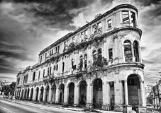 Black and white image of crumbling old building facade with dram Royalty Free Stock Photos