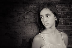 Black and white image of a depressed teenage girl Stock Photo